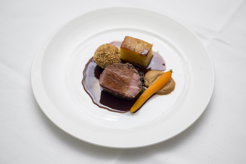Roast Fillet of Tweed Valley of scotch beef , braised cheek, potato terrine , celeriac puree, truffle, port wine reduction
